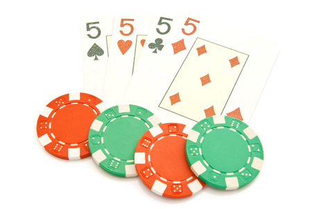 king and queen of hearts: four playing cards and plastic chips on white