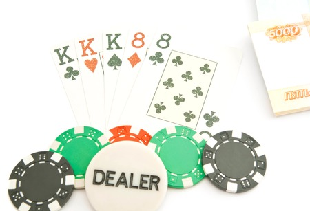 full house: full house combination, chips and rubles on white
