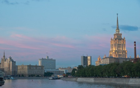 beautiful buildings on the banks of the river at sunset