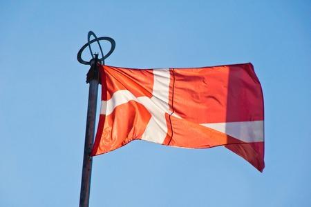flag of denmark on background of summer sky Stock Photo