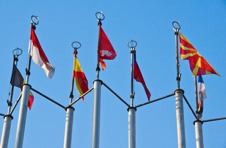 flags of different countries on background of sky