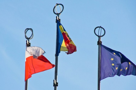 different flags on background of blue sky Stock Photo