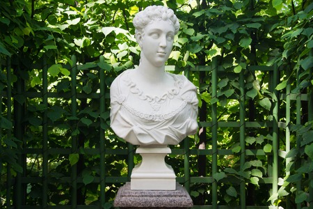 bust: antique bust at the green fence of the park