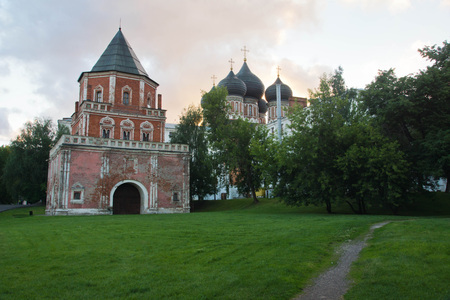 farmstead: view of the red brick tower in the evening