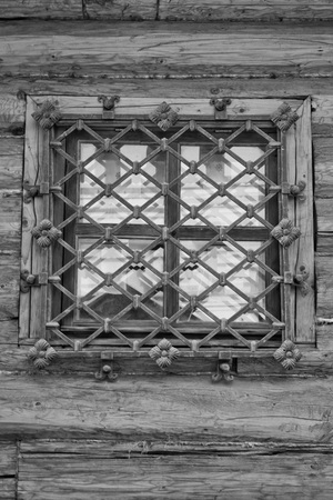 rejas de hierro: window behind iron bars on a wall black and white