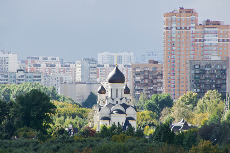view of white stone church in a city park Stock Photo