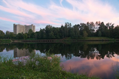 pond and forest at sunset in summer Stock Photo