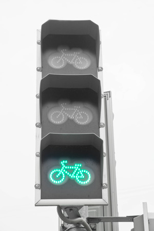 green traffic light for bicyclists on background of the sky Stock Photo