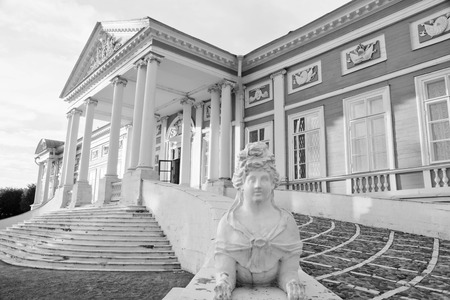 statue near the entrance to an ancient palace black and white