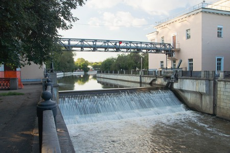 open gateway on the river in summer Stock Photo