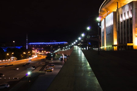 stadium and other buildings in the city at night