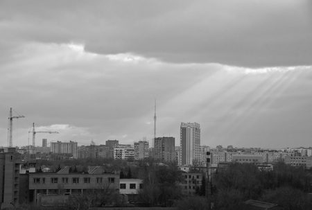 sunbeams breaking through the massive clouds black and white