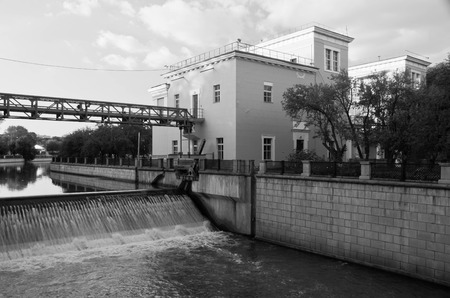 open gateway on the river black and white Stock Photo