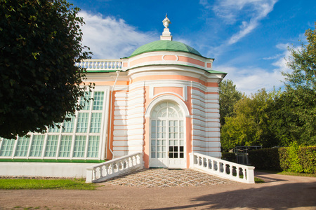 facade of historic building in the summer park Stock Photo