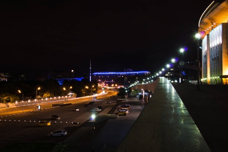 stadium and other buildings in city at night