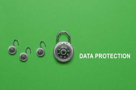 Data protection banner on green Background with combination lock