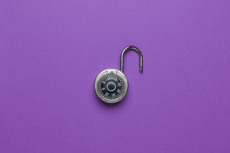 Dial Metal Combo Lock Front View open on purple background used Banco de Imagens