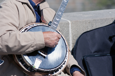 Hands of the man playing the banjo