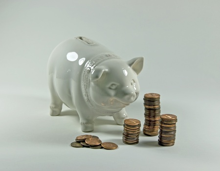 A porcelain piggy bank with stacks of pennies