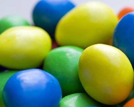 A photograph of green blue yellow and orange hard candies Stock Photo