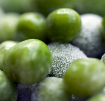 A photograph of bright green frozen shelled peas