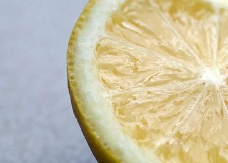 Photograph of a juicy tart slice of lemon Stock Photo