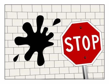 stopped: Stop sign in front on a splat on a brick wall