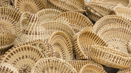 A collection of hand woven baskets crafted from sweet grass Stock Photo