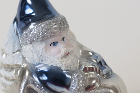 A Christmas tree ornament of a Santa Claus dressed in blue on his sleigh Stock Photo