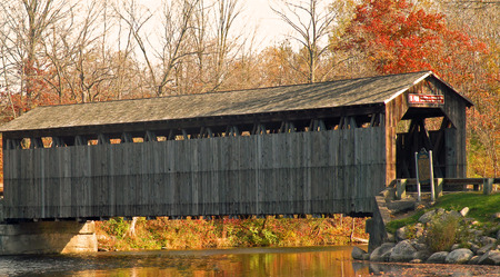A photograph of an historic covered bridge in central Michigan Stock Photo