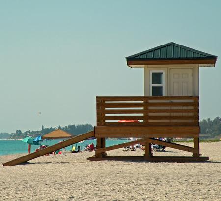 A photograph of a lifeguard shack on the beach in Sarasota Florida