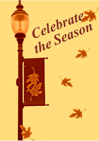 A photograph of a lamppost decorated for Autumn with the words Celebrate the Season