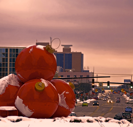 A photo of giant red ornaments decorating the downtown of Lansing Michigan for the Christmas holidays