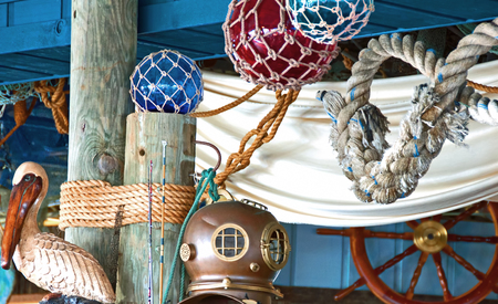 A photo of a collection of nautical decor items having to do with the sea