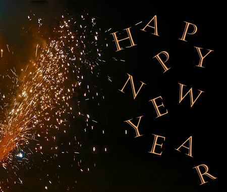 A photo of a fireworks display on a black background enhanced with the text, Happy New Year