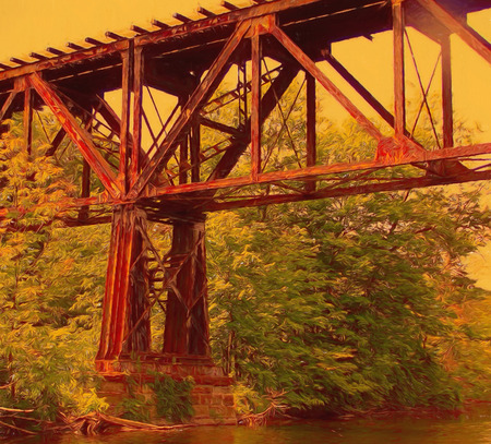 A digitally enhanced photo of an old railroad trestle spanning the river Stock Photo