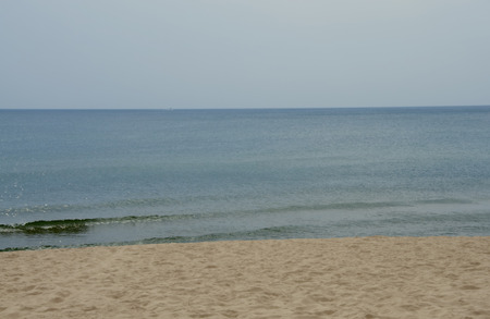 A photograph of a calm day on the beach of Lake Michigan illustrating the calming effects of the complimentary shades of sky, sea, and sand. Stock fotó