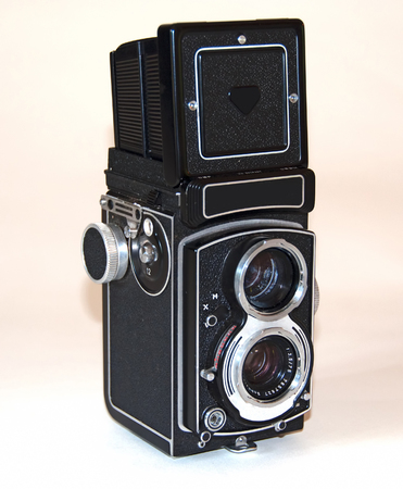 A photo of a German-made vintage camer on a white background with the viewfinder extended