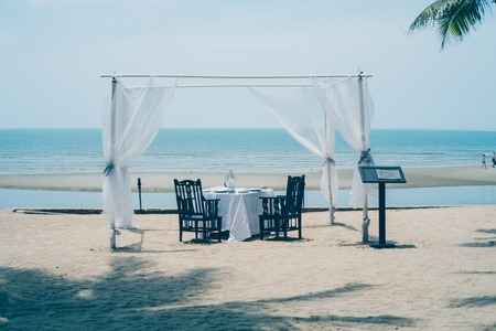 Wedding ceremony setup on the beach with sea and blue sky background. Stock Photo