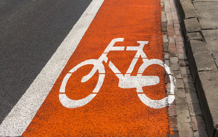 road marking: Bicycle path - Red and white road marking