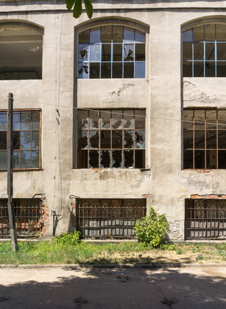warehouse building: Broken windows - old abandoned industrial building - factory, warehouse Stock Photo