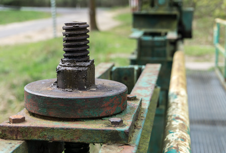 lift lock: Old big screw and nut - part of the lock mechanism of dam - closeup