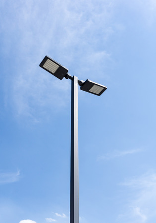halogen lighting: Modern street lighting against blue sky - bottom view - vertical image