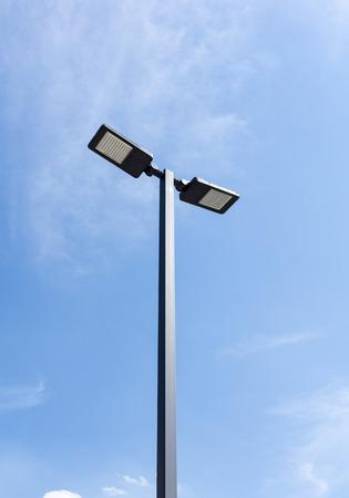 Modern street lighting against blue sky - bottom view - vertical image