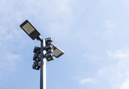 halogen lighting: Modern street lighting against blue sky - bottom view - horizontal image