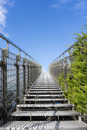 heaven background: Stairway to heaven - steel staircase going up to a blue sky with clouds