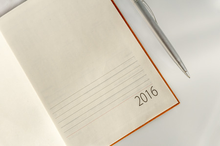 sliver: New Year 2016 office calendar and organizer sliver ball pen. Selective focus
