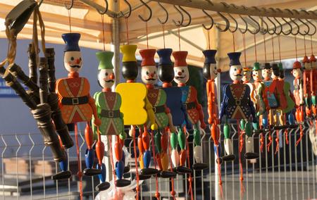 toys: Traditional wooden toys, dolls, slingshots - Wooden toy fair -  Street market  - Nobody - Horizontal image