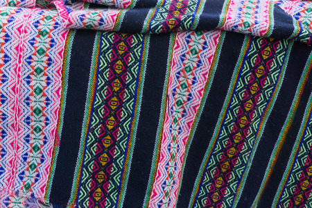 hand woven: Ancient Andean colored fabrics woven by hand as background