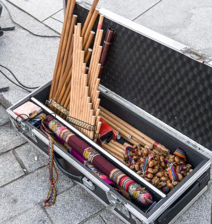 panpipe: Andean musical instruments in case on street. Pan flutes, zampona, siku.  Folk music.